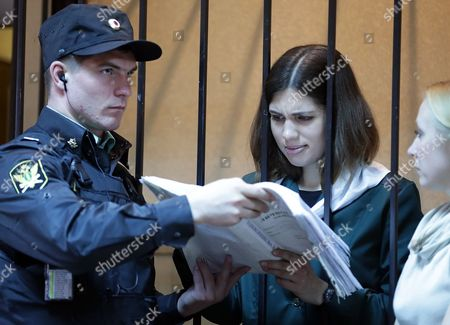 Russian Feminist Punk-rock Band Pussy Riot Member Nadezhda Tolokonnikova (c) Reads a Document During a Court Session at the Zubova Polyana District Court in Town of Zubova Polyana 440 Km Southeast From Moscow Republic of Mordovia Russia 26 April 2013 the Court Considers Nadezhda Tolokonnikova's Appeal For Parole in August 2012 Three Members of Russian Feminist Punk-rock Band Pussy Riot Yekaterina Samutsevich Maria Alyokhina and Nadezhda Tolokonnikova Were Sentenced to Two Years in Prison on Charges of Hooliganism Motivated by Religious Hatred After Singing a Song in the Christ the Savior Cathedral in Moscow in February 2012 Ahead of Presidential Elections in Russia Russian Federation Zubova Polyana