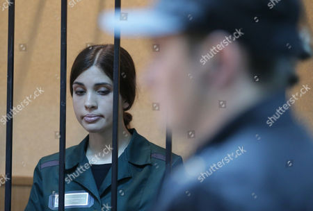Russian Feminist Punk-rock Band Pussy Riot Member Nadezhda Tolokonnikova Locked in a Cage Listens to the Court Verdict During a Court Session at the Zubova Polyana District Court in the Town of Zubova Polyana 440 Km Southeast From the Center of Moscow Russia 26 April 2013 the Court Rejected Tolokonnikova's Appeal For Parole in August 2012 Russian Feminist Punk-rock Band Pussy Riot Three Members Yekaterina Samutsevich Maria Alyokhina and Nadezhda Tolokonnikova Were Sentenced to Two-year Prison on Charges of Hooliganism Motivated by Religious Hatred After Singing a Song in the Christ the Savior Cathedral in Moscow in February 2012 Ahead of Presidential Elections in Russia Later the Court Replaced Yekaterina Samutsevich's Jail Term For a Suspended Sentence Russian Federation Zubova Polyana