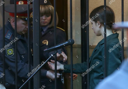 Russian Feminist Punk-rock Band Pussy Riot Member Nadezhda Tolokonnikova is Freed From Her Handcuffs As She Attends a Court Session While Locked Inside a Cage at the Zubova Polyana District Court in Town of Zubova Polyana 440 Km Southeast From the Center of Moscow Republic of Mordovia Russia 26 April 2013 the Court Rejected Tolokonnikova's Appeal For Parole in August 2012 Russian Feminist Punk-rock Band Pussy Riot Three Members Yekaterina Samutsevich Maria Alyokhina and Nadezhda Tolokonnikova Were Sentenced to Two-year Prison on Charges of Hooliganism Motivated by Religious Hatred After Singing a Song in the Christ the Savior Cathedral in Moscow in February 2012 Ahead of Presidential Elections in Russia Later the Court Replaced Yekaterina Samutsevich's Jail Term For a Suspended Sentence Epa/maxim Shipenkov Russian Federation Zubova Polyana