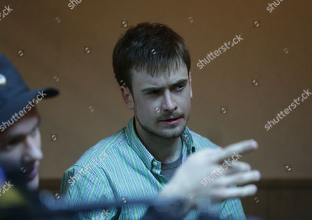 Stock Image of Pyotr Verzilov (r) Husband of Russian Feminist Punk-rock Band Pussy Riot Member Nadezhda Tolokonnikova is Seen Before a Court Session at the Zubova Polyana District Court in Town of Zubova Polyana 440 Km Southeast From the Center of Moscow Republic of Mordovia Russia 26 April 2013 the Court Rejected Tolokonnikova's Appeal For Parole in August 2012 Russian Feminist Punk-rock Band Pussy Riot Three Members Yekaterina Samutsevich Maria Alyokhina and Nadezhda Tolokonnikova Were Sentenced to Two-year Prison on Charges of Hooliganism Motivated by Religious Hatred After Singing a Song in the Christ the Savior Cathedral in Moscow in February 2012 Ahead of Presidential Elections in Russia Later the Court Replaced Yekaterina Samutsevich's Jail Term For a Suspended Sentence Russian Federation Zubova Polyana