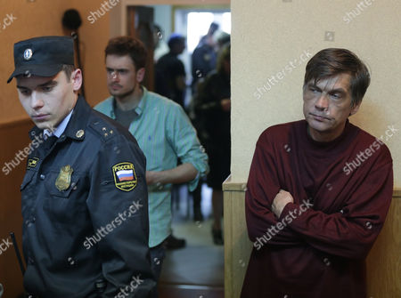 Pyotr Verzilov (c) Husband and Andrei Tolokonnikov (r) Father of Russian Feminist Punk-rock Band Pussy Riot Member Nadezhda Tolokonnikova Are Seen During a Court Session at the Zubova Polyana District Court in Town of Zubova Polyana 440 Km Southeast From the Center of Moscow Republic of Mordovia Russia 26 April 2013 the Court Rejected Tolokonnikova's Appeal For Parole in August 2012 Russian Feminist Punk-rock Band Pussy Riot Three Members Yekaterina Samutsevich Maria Alyokhina and Nadezhda Tolokonnikova Were Sentenced to Two-year Prison on Charges of Hooliganism Motivated by Religious Hatred After Singing a Song in the Christ the Savior Cathedral in Moscow in February 2012 Ahead of Presidential Elections in Russia Later the Court Replaced Yekaterina Samutsevich's Jail Term For a Suspended Sentence Russian Federation Zubova Polyana