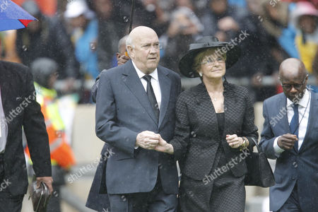 Stock Picture of Former South African President and Fellow Nobel Peace Prize Recipient F W De Klerk (c) and His Wife Elita (c-r) Arrive For the Beginning of the Official Memorial Ceremony For Late South African President Nelson Mandela at Fnb Stadium in Johannesburg South Africa 10 December 2013 Nobel Peace Prize Winner Nelson Mandela Died on 05 December at the Age of 95 South Africa Johannesburg