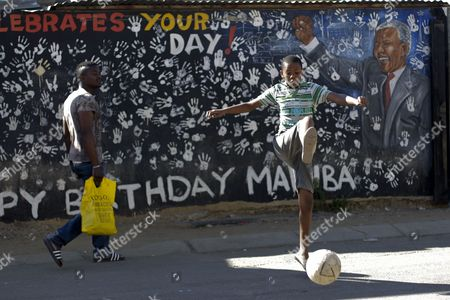 A Boy Plays Football in Front of a Mural Depicting Former South African President Nelson Mandela in Alexandra Township where Mandela Rented a Room when He First Came to Johannesburg in 1941 South Africa 03 July 2013 According to a Local Report Nelson Mandela's Eldest Daughter Makaziwe Mandela Confirmed That Nelson Mandela is on Life Support and 'The Anticipation of His Impending Death is Based on Real and Substantial Grounds' Citing an Affidavit Filed by Family Members For an Ongoing Family Dispute Over Nelson Mandela's Burial Site South Africa Johannesburg