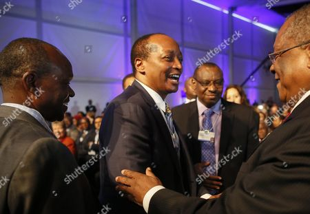Founder and Executive Chairman African Rainbow Minerals South Africa Patrice Motsepe (c) Greets Leaders During the World Economic Forum on Africa at the Cape Town International Convention Centre South Africa 04 June 2015 the World Economic Forum on Africa in 2015 Marks 25 Years of Change on the Continent According to the World Economic Forum Over the Past Fifteen Years Africa Has Demonstrated an Economic Turnaround Growing Two to Three Percentage Points Faster Than Global Gdp Some of the Highlight Discussions at This Years Meeting Focus on Food Security and Agriculture and Also the Various Options and Areas of Investment South Africa Cape Town