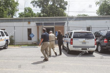 Attorney Carine Williams (r) Arrives at the West Feliciana Parish Detention Center in St Francisville Louisiana Usa 12 June 2015 where Her Client Inmate Albert Woodfox is Being Held Pending a Judge's Ruling Warden Randall Holden (c) and Brian Spillman (l) Director of Parish Homeland Security Discuss Logistics Woodfox Has Spent the Last 43 Years in Solitary Confinement Woodfox was Twice Convicted of Killing Louisiana State Penitentiary Guard Brent Miller in April 1972 Two Other Inmates Also Convicted who Served Time in Solitary Confinement Were Previously Released Woodfox the Last of the 'Angola Three ' was Ordered Released by Us District Judge James J Brady and the Decision is in the Hands of the 5th Circuit Court of Appeals United States St. Francisville
