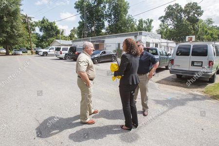 Attorney Carine Williams Arrives at the West Feliciana Parish Detention Center in St Francisville Louisiana Usa 12 June 2015 where Her Client Inmate Albert Woodfox is Being Held Pending a Judge's Ruling Warden Randall Holden (left) and Brian Spillman Director of Parish Homeland Security Discuss Logistics Woodfox Has Spent the Last 43 Years in Solitary Confinement Woodfox was Twice Convicted of Killing Louisiana State Penitentiary Guard Brent Miller in April 1972 Two Other Inmates Also Convicted who Served Time in Solitary Confinement Were Previously Released Woodfox the Last of the 'Angola Three ' was Ordered Released by Us District Judge James J Brady and the Decision is in the Hands of the 5th Circuit Court of Appeals United States St. Francisville