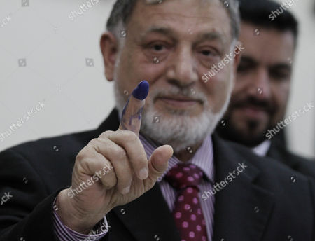 Mohammad Yousuf Nooristani (c) Head of the Independent Election Commission Tests the Indelible Ink to Be Used During Afghan Presidential Elections 2014 in Kabul Afghanistan 09 December 2013 Afghan Presidential Elections Are Slated For April 2014 Afghanistan Kabul