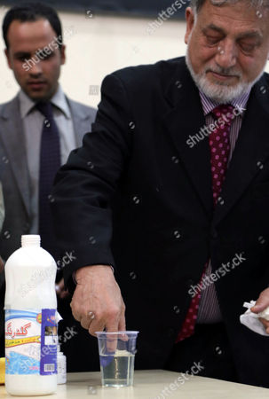 Mohammad Yousuf Nooristani (r) Head of the Independent Election Commission Tests the Indelible Ink to Be Used During Afghan Presidential Elections 2014 in Kabul Afghanistan 09 December 2013 Afghan Presidential Elections Are Slated For April 2014 Afghanistan Kabul