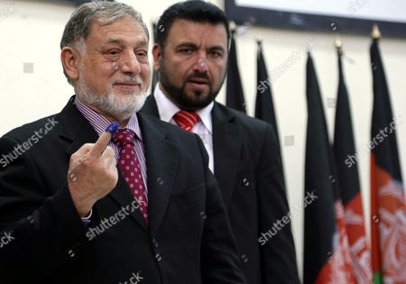 Mohammad Yousuf Nooristani (l) Head of the Independent Election Commission Tests the Indelible Ink to Be Used During Afghan Presidential Elections 2014 in Kabul Afghanistan 09 December 2013 Afghan Presidential Elections Are Slated For April 2014 Afghanistan Kabul