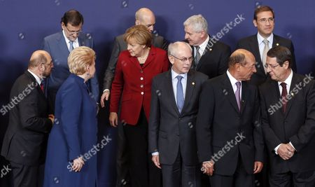 (l-r Front) European Parliament President Martin Schulz Lithuanian President Dalia Grybauskaite German Chancellor Angela Merkel European Council President Herman Van Rompuy Romanian President Traian Basescu Cypriot President Nicos Anastasiades (l-r Back) Spanish Prime Minister Mariano Rajoy Swedish Prime Minister Fredrik Reinfeldt Czech Prime Minister Jiri Rusnok and Portuguese Prime Minister Pedro Passos Coelho Pose For a Family Photo During the European Council Summit in Brussels Belgium 24 October 2013 the European Council Summit on 24 and 25 October Will Focus on Economic and Social Policy Issues the Economic and Monetary Union As Well As Migratory Flows and Migration Policy Belgium Brussels