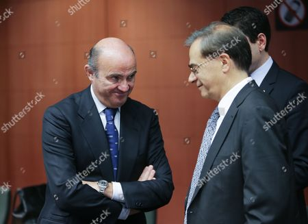 Spanish Minister of Economy Luis De Guindos (l) and Greek Finance Minister Gikas Hardouvelis at the Start of Eurogroup with European Finance Ministers Meeting at Eu Council Headquarters in Brussels Belgium 8 December 2014 Belgium Brussels