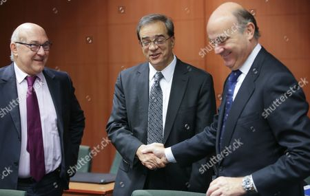 French Finance Minister Michel Sapin (l) Greek Finance Minister Gikas Hardouvelis (c) and Spanish Minister of Economy Luis De Guindos (r) at the Start of Eurogroup with European Finance Ministers Meeting at Eu Council Headquarters in Brussels Belgium 8 December 2014 Belgium Brussels