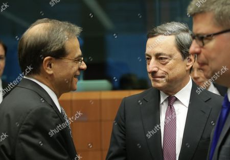 Greek Finance Minister Gikas Hardouvelis and President of the European Central Bank (ecb) Mario Draghi (r) at the Start of Eurogroup with European Finance Ministers Meeting at Eu Council Headquarters in Brussels Belgium 8 December 2014 Belgium Brussels