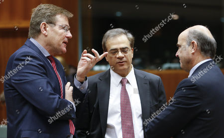 (l-r) Belgian Finance Minister Johan Van Overtveldt Outgoing Greek Finance Minister Gikas Hardouvelis and Spanish Minister of Economy Luis De Guindos at the Start of European Finance Ministers Meeting at Eu Council Headquarters in Brussels Belgium 27 January 2015 Belgium Brussels