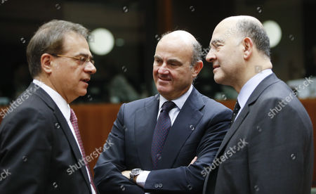 (l-r) out Going Greek Finance Minister Gikas Hardouvelis Spanish Minister of Economy Luis De Guindos and Eu Commissioner in Charge of Economic and Financial Affairs Taxation and Customs Union Pierre Moscovici at the Start of European Finance Ministers Meeting at Eu Council Headquarters in Brussels Belgium 27 January 2015 Belgium Brussels