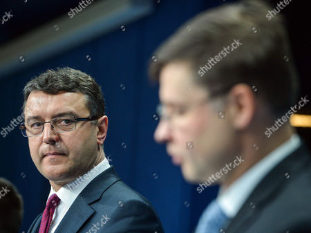 Latvia's Finance Minister Janis Reirs (l) and European Commission Vice-president in Charge of the Euro and Social Dialogue Valdis Dombrovskis (r) of Latvia Hold a Joint News Conference at the End of European Finance Ministers Meeting at Eu Council Headquarters in Brussels Belgium 27 January 2015 Belgium Brussels