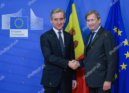 Moldovan Prime Minister Iurie Leanca (l) is Welcomed by European Commissioner For European Neighbourhood Policy and Enlargement Johannes Hahn Prior to a Meeting at the Eu Council Headquarters in Brussels Belgium 18 December 2014 Belgium Brussels