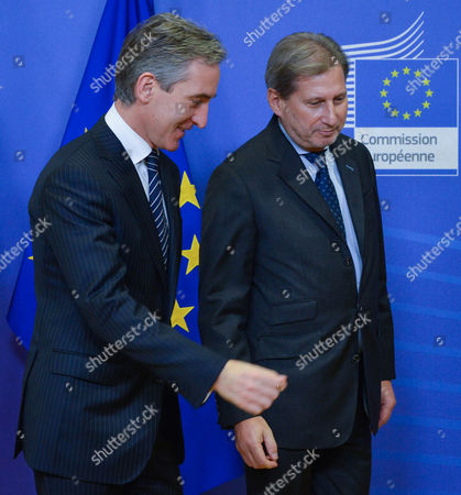Stock Picture of Moldovan Prime Minister Iurie Leanca (l) is Welcomed by European Commissioner For European Neighbourhood Policy and Enlargement Johannes Hahn Prior to a Meeting at the Eu Council Headquarters in Brussels Belgium 18 December 2014 Belgium Brussels