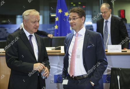Eu Commissioner-designate As Vice President in Charge of Jobs Growth Investment and Competitiveness Finnish Jyrki Katainen (r) Chats with Former European Commissioner Responsible For Economic and Monetary Affairs and Euro Finnish Olli Rehn (l) During a Hearing at the European Parliament in Brussels Belgium 07 October 2014 the European Parliament Has Started Quizzing the 27 Men and Women who Have Been Picked to Serve in the New European Commission the Hearings Are Due to Last at Least Three Hours Each Belgium Brussels