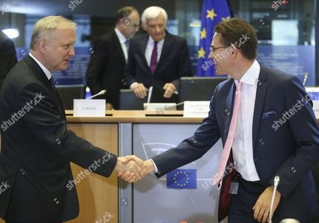 Eu Commissioner-designate As Vice President in Charge of Jobs Growth Investment and Competitiveness Finnish Jyrki Katainen (r) Shakes Hands with Former European Commissioner Responsible For Economic and Monetary Affairs and Euro Finnish Olli Rehn (l) During a Hearing at the European Parliament in Brussels Belgium 07 October 2014 the European Parliament Has Started Quizzing the 27 Men and Women who Have Been Picked to Serve in the New European Commission the Hearings Are Due to Last at Least Three Hours Each Belgium Brussels