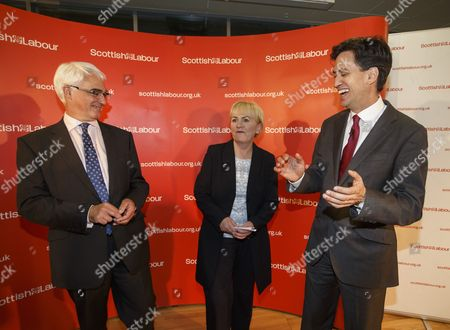 Labour Leader Ed Miliband (r) Acknowledges Better Together Leader Former Labour Government Chancellor of the Exchequer Alistair Darling (l) and Scottish Labour Leader Johann Lamont (c) Contributions to the Better Together Winning Campaign at Meeting of Labour Party Campaigners After Their Victory at the Emirates Arena Glasgow Scotland 19 September 2014 Scotland Has Voted to Remain Part of the United Kingdom by 55 Per Cent to 45 Per Cent Officials Said Early 19 September 2014 After All Votes in the Historic Independence Referendum Were Counted United Kingdom Glasgow