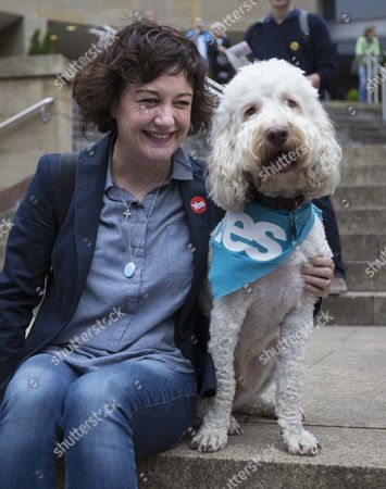 Lorraine Mcintosh Singer with the Scottish Group Deacon Blue Hugs Her Dog That Wears a Yes Scarf During a Final Rally by Supporters of the Yes Campaign on the Steps of the Royal Concert Hall in Glasgow Scotland 17 September 2014 Both Sides in the Scottish Referendum Were Holding Rallies During the Day to Win Over Undecided Voters That Hold the Key to the Outcome on the Eve of the Vote United Kingdom Glasgow