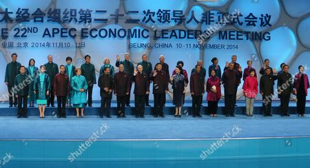 Leaders and Their Spouses of Member Countries of Asia-pacific Economic Cooperation (apec) Pose For a Family Photo at the Water Cube Or National Aquatic Center Before a Welcome Banquet in Beijing China 10 November 2014 the Asia-pacific Economic Cooperation (apec) 2014 Summit and Related Meetings Will Be Held in Beijing From 05 to 11 November Gathering Leaders of 21 Member Economies (front L-r) Taiwanese Representative Vincent Siew Mexican President's Wife Angelica Rivera and President Enrique Pena Nieto Chilean President Michelle Bachelet Sultan of Brunei Hassanal Bolkiah Philippine President Benigno Aquino Iii Russian President Vladimir Putin Chinese President Xi Jinping and His Wife Peng Liyuan Indonesian President Joko Widodo and Wife Iriana Us President Barack Obama South Korean President Park Geun-hye Peruvian President Ollanta Humala Thai Prime Minister Prayut Chan-o-cha and Wife Naraporn (back L-r) Hong Kong 'S Chief Executive Leung Chun-ying New Zealand Prime Minister's Wife Bronagh Key and Prime Minister John Key Japanese Prime Minister's Wife Akie and Prime Minister Shinzo Abe Canadian Prime Minister's Wife Laureen and Prime Minister Stephen Harper Australian Prime Minister Tony Abbott Malaysian Prime Minister Najib Razak and Wife Rosmah-mansor Papua New Guinea Prime Minister Peter O?neill and Wife Lynda May Babao Singapore Prime Minister Lee Hsien Loong and Wife Ho Ching Vietnam's President Truong Tan Sang and Wife Mai Thi Hanh China Beijing