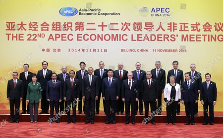 Leaders of Member Countries of Asia-pacific Economic Cooperation (apec) Pose For a Family Photo at the International Convention Center at Yanqi Lake in Beijing China 11 November 2014 the Asia-pacific Economic Cooperation (apec) 2014 Summit and Related Meetings Will Be Held in Beijing From 05 to 11 November Gathering Leaders of 21 Member Economies (front L-r) Peruvian President Ollanta Humala South Korean President Park Geun-hye Sultan of Brunei Hassanal Bolkiah Indonesian President Joko Widodo Us President Barack Obama Chinese President Xi Jinping Russian President Vladimir Putin Philippine President Benigno Aquino Iii Chilean President Michelle Bachelet Mexican President Enrique Pena Nieto Vietnam's President Truong Tan Sang (back L-r) Taiwanese Envoy to Apec Summit Vincent Siew Thai Prime Minister Prayut Chan-o-cha Papua New Guinea Prime Minister Peter O?neill Japanese Prime Minister Shinzo Abe Australian Prime Minister Tony Abbott Malaysian Prime Minister Najib Razak New Zealand Prime Minister John Key Singapore Prime Minister Lee Hsien Loong Hong Kong's Chief Executive Leung Chun-ying and Canadian Prime Minister Stephen Harper China Beijing