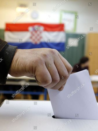 A Croatian Man Casts His Ballot During the Second Round of the Presidential Election in Zagreb Croatia 11 January 2015 Polls Opened in Croatia As Voters Cast Their Ballots in what is Expected to Be a Closely-fought Presidential Run-off Between the Incumbent Social Democrat (sdp) Ivo Josipovic and His Conservative Challenger Kolinda Grabar-kitarovic Croatia Zagreb