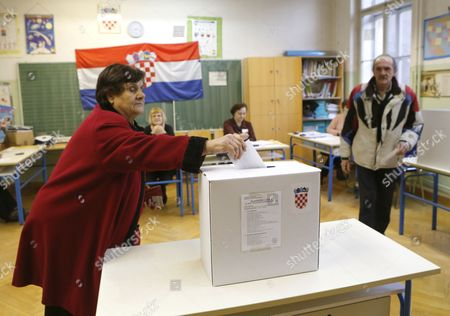 A Croatian Woman Casts Her Ballot During the Second Round of the Presidential Election in Zagreb Croatia 11 January 2015 Polls Opened in Croatia As Voters Cast Their Ballots in what is Expected to Be a Closely-fought Presidential Run-off Between the Incumbent Social Democrat (sdp) Ivo Josipovic and His Conservative Challenger Kolinda Grabar-kitarovic Croatia Zagreb