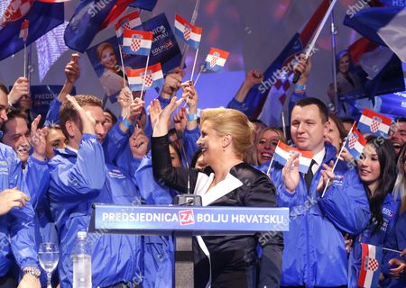 Kolinda Grabar Kitarovic (c) Celebrates Her Victory Against Ivo Josipovic in the Presidential Elections in Zagreb Croatia 11 January 2015 Kolinda Grabar-kitarovic Defeated Incumbent Social Democrat Ivo Josipovic in a Run-off Vote to Become the First Female President in Croatia Since Its Independence and the First Conservative in the Office in 15 Years Croatia Zagreb