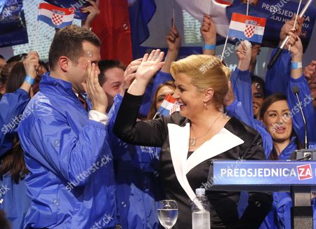 Kolinda Grabar Kitarovic (r) Celebrates Her Victory Against Ivo Josipovic in the Presidential Elections in Zagreb Croatia 11 January 2015 Kolinda Grabar-kitarovic Defeated Incumbent Social Democrat Ivo Josipovic in a Run-off Vote to Become the First Female President in Croatia Since Its Independence and the First Conservative in the Office in 15 Years Croatia Zagreb
