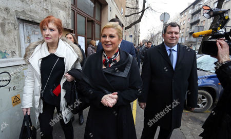 Presidential Candidate of Croatian Democratic Union (hdz) Kolinda Grabar-kitarovic (c) and Her Husband Jakov (r) Leave a Polling Station After Voting in Zagreb Croatia 11 January 2015 Polls Opened in Croatia As Voters Cast Their Ballots in what is Expected to Be a Closely-fought Presidential Run-off Between the Incumbent Social Democrat (sdp) Ivo Josipovic and His Conservative Challenger Kolinda Grabar-kitarovic Croatia Zagreb