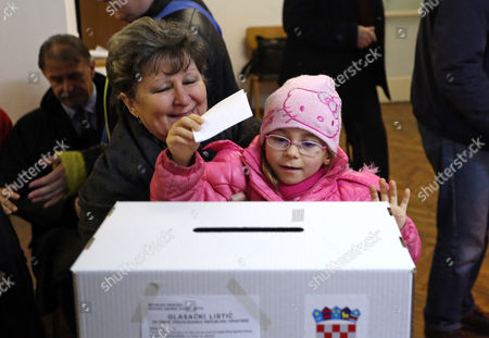 A Croatian Girl Casts a Ballot at a Polling Station in Zagreb Croatia 11 January 2015 Polls Opened in Croatia As Voters Cast Their Ballots in what is Expected to Be a Closely-fought Presidential Run-off Between the Incumbent Social Democrat (sdp) Ivo Josipovic and His Conservative Challenger Kolinda Grabar-kitarovic Croatia Zagreb