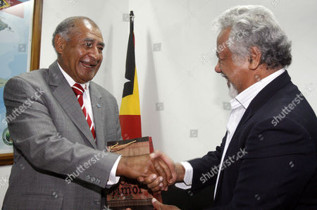 Stock Photo of Fiji's President Ratu Epeli Nailatikau (l) is Greeted by to East Timor's Prime Minister Xanana Gusmao (r) During Their Meeting in Dili East Timor 28 February 2014 Ratu Epeli Nailatikau is in a Two-day Visit to East Timor Also Known As Timor Leste to Tighten Bilateral Relationship Between the Two Countries East Timor Dili