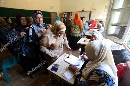 Egyptians Women Register Their Names to Vote During the Presidential Elections at a Polling Station in Heliopolis District Cairo Egypt 26 May 2014 Egyptians Began on 26 May Two Days of Voting to Elect a New President in the First Elections Since the Army Deposed Islamist President Mohamed Morsi More Than 11 Months Ago the Election is a Two-man Race Between Former Army Chief Abdel Fattah Al-sisi and Leftist Politician Hamdeen Sabahi Egypt Cairo