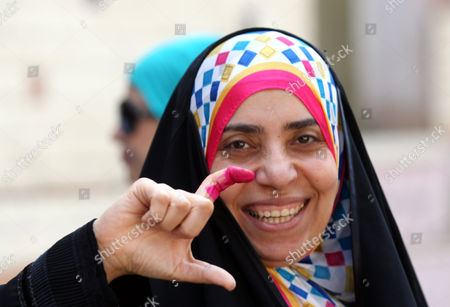 A Voter Shows Her Ink Marked Finger After Voting During the Presidential Elections at a Polling Station in Heliopolis District Cairo Egypt 26 May 2014 Egyptians Began on 26 May Two Days of Voting to Elect a New President in the First Elections Since the Army Deposed Islamist President Mohamed Morsi More Than 11 Months Ago the Election is a Two-man Race Between Former Army Chief Abdel Fattah Al-sisi and Leftist Politician Hamdeen Sabahi Egypt Cairo
