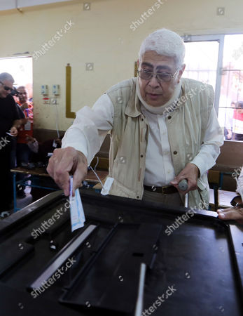 An Egyptian Man Casts His Ballot Paper During Presidential Elections at a Polling Station in Heliopolis District Cairo Egypt 26 May 2014 Egyptians Began on 26 May Two Days of Voting to Elect a New President in the First Elections Since the Army Deposed Islamist President Mohamed Morsi More Than 11 Months Ago the Election is a Two-man Race Between Former Army Chief Abdel Fattah Al-sisi and Leftist Politician Hamdeen Sabahi Egypt Cairo