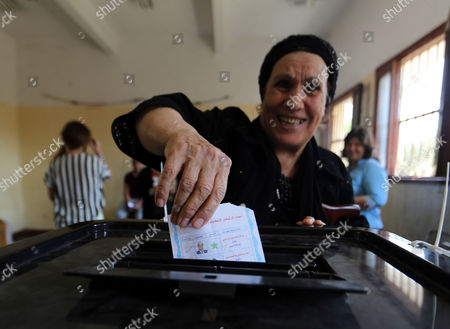 An Egyptian Woman Casts Her Ballot Paper During Presidential Elections at a Polling Station in Heliopolis District Cairo Egypt 26 May 2014 Egyptians Began on 26 May Two Days of Voting to Elect a New President in the First Elections Since the Army Deposed Islamist President Mohamed Morsi More Than 11 Months Ago the Election is a Two-man Race Between Former Army Chief Abdel Fattah Al-sisi and Leftist Politician Hamdeen Sabahi Egypt Cairo