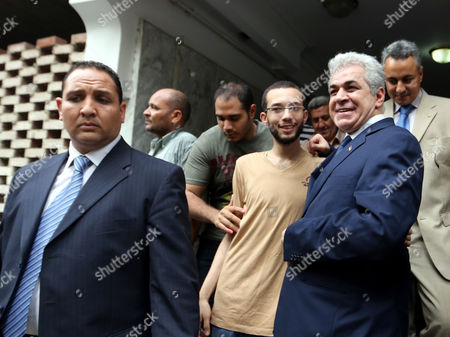Egypt's Leftist Presidential Contender Hamdeen Sabahi (r) Leaves After a Press Conference in Cairo Egypt 29 May 2014 Sabahi Conceded His Defeat in This Week's Presidential Elections 'I Respect Egyptians' Choice and Admit My Loss ' He Told the Press Conference 'We Have Lost a Round But i Am Sure We'll Ultimately Win in Fulfilling These People's Dreams ' Unofficial Results Showed That Former Army Chief Abdel-fattah Al-sisi Has Won a Landslide Victory in Egypt's Presidential Election with 96 9 Per Cent of the Valid Ballots Egypt Cairo