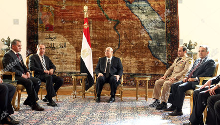 Egyptian Interim President Adli Mansour (c) Meets with Russian Defense Minister Sergei Shoigu (l) and Russian Foreign Minister Sergei Lavrov (2-l) in the Presence of Egyptian Minister of Defense Abdel Fattah Al-sisi (2-r) and Egyptian Foreign Minister Nabil Fahmy (r) in Cairo Egypt 14 November 2013 Russian Defense Minister Sergei Shoigu and Foreign Minister Sergei Lavrov Are to Meet on 14 November with Their Egyptian Counterparts As Well As with Caretaker President Adly Mansour the First Such Talks Between Senior Officials From the Two Countries in Years Media Reported There Have Been Reports That Egypt's Military is Looking For Arms Suppliers Other Than the United States Which Suspended Deliveries of Military Hardware and Cash Aid After the Army Overthrew Islamist President Mohamed Morsi in July 2013 Egypt Cairo