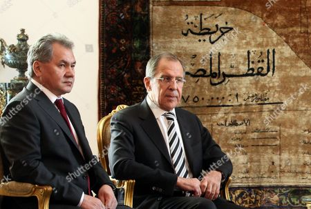 Stock Image of Russian Foreign Minister Sergei Lavrov (r) and Russian Defense Minister Sergei Shoigu (l) Look on During Meeting with Egyptian Interim President Adli Mansour (not Pictured) in Cairo Egypt 14 November 2013 Russian Defense Minister Sergei Shoigu and Foreign Minister Sergei Lavrov Are to Meet on 14 November with Their Egyptian Counterparts As Well As with Caretaker President Adly Mansour the First Such Talks Between Senior Officials From the Two Countries in Years Media Reported There Have Been Reports That Egypt's Military is Looking For Arms Suppliers Other Than the United States Which Suspended Deliveries of Military Hardware and Cash Aid After the Army Overthrew Islamist President Mohamed Morsi in July 2013 Egypt Cairo