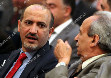 Former Syrian Coalition Head Ahmad Al-jarba (l) Attends the Opening Session of Syrian Opposition Conference in Cairo Egypt 08 June 2015 the Conference Entitled 'Towards Political Solution in Syria' Will Discuss Efforts of Uniting Various Opposition Factions to End the Four-year War in Syria Egypt Cairo