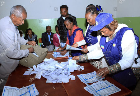 Stock Picture of A Photo Made Available 25 May 2015 of Ethiopian Election Officers Counting Votes at the Bole Subcity Polling Station in the Capital Addis Ababa Ethiopia Late 24 May2015 the Elections Are the First Since the Death of Prime Minister Meles Zenawi and It is Expected That His Successor Hailemariam Desalegn Will Stay in Office Nearly 37 Million People of a Population of 94 Million Had Registered to Vote in the Elections Which Featured 58 Parties Ethiopia Addis Ababa