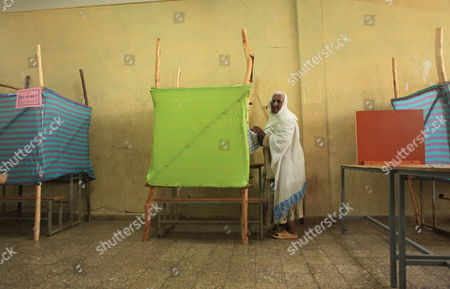 Stock Image of An Elderly Woman Votes in the 'Kechene Medianealem' Church in the Ethiopian Presidential in the Capital Addis Ababa Ethiopia 24 May2015 the Elections Are the First Since Since the Death of Prime Minister Meles Zenawi and It is Expected That His Successor Hailemariam Desalegn is Certain to Stay in Office an Estimated 37 Million People Are Thought to Vote Today Ethiopia Addis Ababa