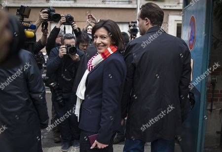 Parti Socialist (ps) Political Party Candidate For Paris' 2014 Municipal Election Anne Hidalgo (l) and Her Partner Jean-marc Germain (r) Exit the Polling Station During the Second Round of the 2014 Municipal Election in Paris France 30 March 2014 in Paris the Race Pits Outgoing Socialist Mayor Bertrand Delanoe's Deputy Anne Hidalgo Against Former Environment Minister Nathalie Kosciusko-morizet of the Centre-right Union For a Popular Movement (ump) France Paris