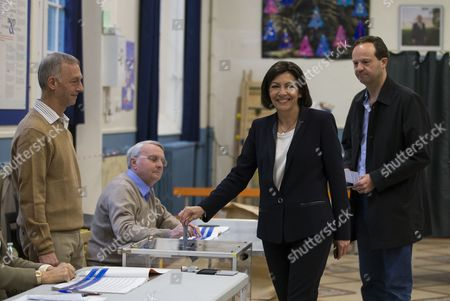 Parti Socialist (ps) Political Party Candidate For Paris' 2014 Municipal Election Anne Hidalgo (2nd R) and Her Partner Jean-marc Germain (r) Casts Her Ballot During the Second Round of the 2014 Municipal Election in Paris France 30 March 2014 in Paris the Race Pits Outgoing Socialist Mayor Bertrand Delanoe's Deputy Anne Hidalgo Against Former Environment Minister Nathalie Kosciusko-morizet of the Centre-right Union For a Popular Movement (ump) France Paris