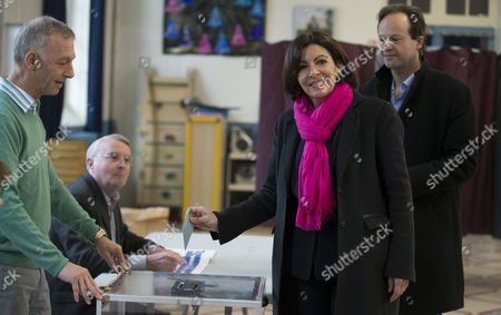 Anne Hidalgo (2-r) the Parti Socialist (ps) Political Party Candidate For Paris' 2014 Municipal Election and Her Partner Jean-marc Germain (r) Prepare to Cast Their Ballots During the First Round of the 2014 Municipal Election at a Polling Station in Paris France 20 March 2014 in Paris the Race Pits Outgoing Socialist Mayor Bertrand Delanoe's Deputy Anne Hidalgo Against Former Environment Minister Nathalie Kosciusko-morizet of the Centre-right Union For a Popular Movement (ump) France Paris