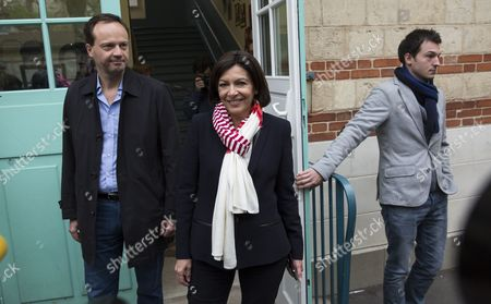 Parti Socialist (ps) Political Party Candidate For Paris' 2014 Municipal Election Anne Hidalgo (c) and Her Partner Jean-marc Germain (l) Exit the Polling Station During the Second Round of the 2014 Municipal Election in Paris France 30 March 2014 in Paris the Race Pits Outgoing Socialist Mayor Bertrand Delanoe's Deputy Anne Hidalgo Against Former Environment Minister Nathalie Kosciusko-morizet of the Centre-right Union For a Popular Movement (ump) France Paris
