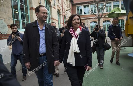 Parti Socialist (ps) Political Party Candidate For Paris' 2014 Municipal Election Anne Hidalgo (r) and Her Partner Jean-marc Germain (l) Exit the Polling Station During the Second Round of the 2014 Municipal Election in Paris France 30 March 2014 in Paris the Race Pits Outgoing Socialist Mayor Bertrand Delanoe's Deputy Anne Hidalgo Against Former Environment Minister Nathalie Kosciusko-morizet of the Centre-right Union For a Popular Movement (ump) France Paris